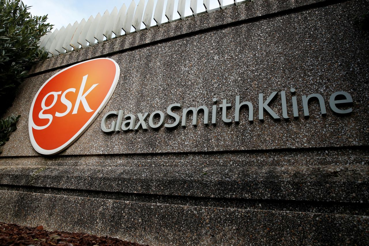 FILE PHOTO: Company logo of pharmaceutical company GlaxoSmithKline is seen at their Stevenage facility, Britain October 26, 2020. REUTERS/Matthew Childs/File Photo