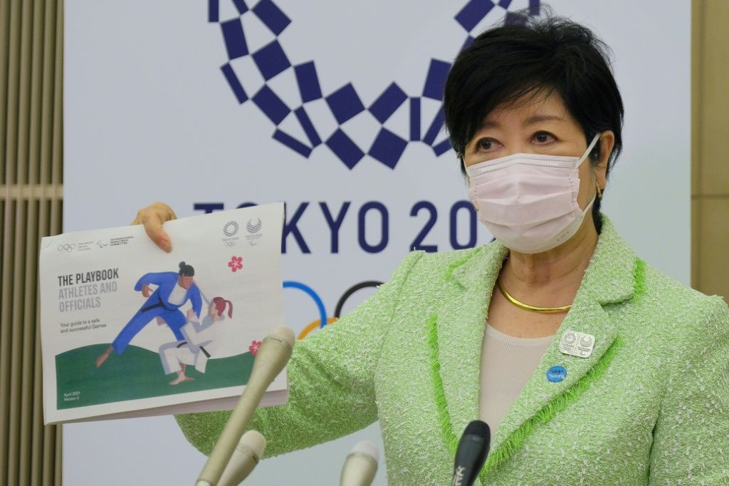 Tokyo Governor Yuriko Koike unveiled the Olympics 'playbook' aimed at stopping virus outbreaks. AFP
