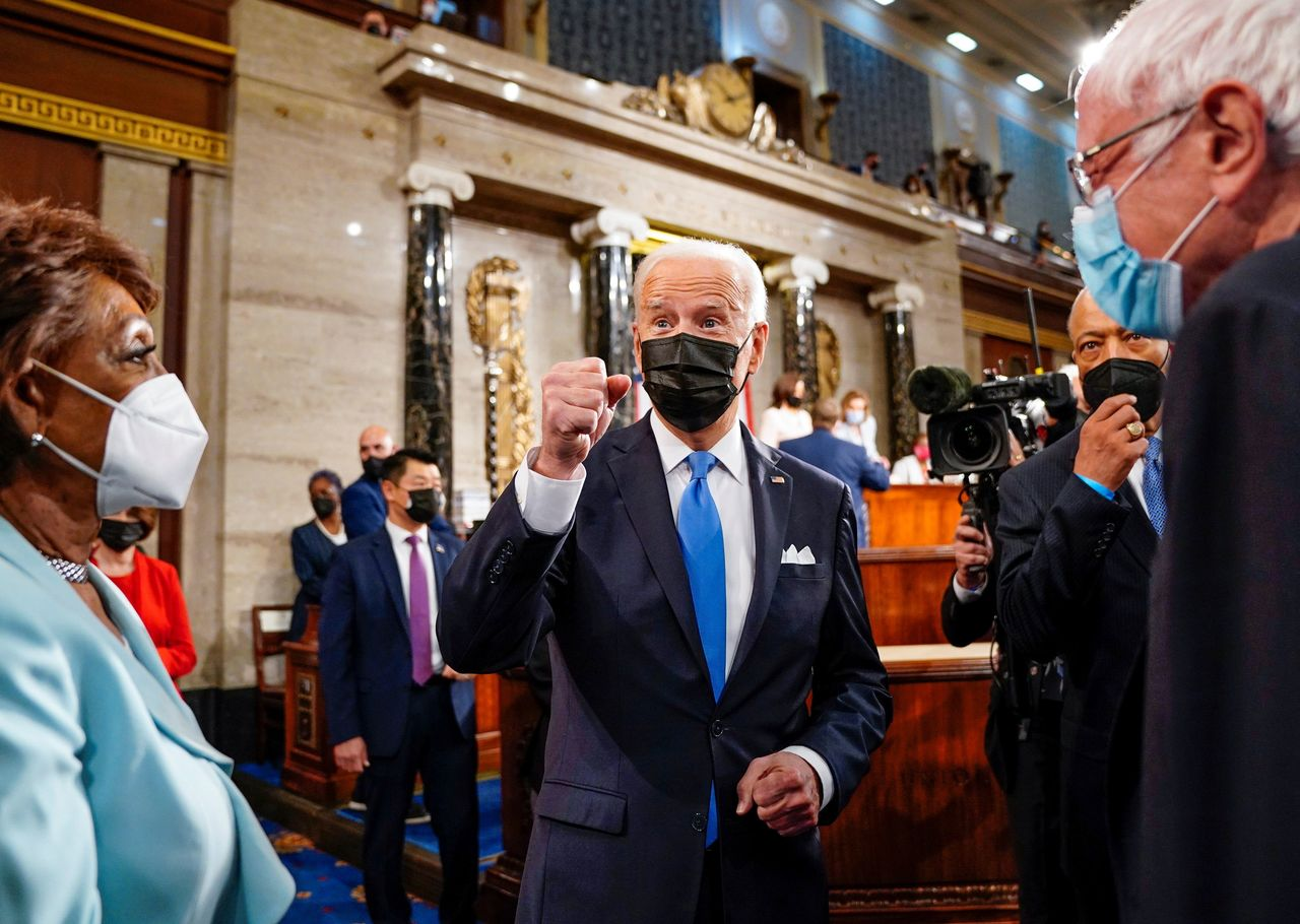 U.S. President Joe Biden gestures as he leaves the House Chamber with Rep. Maxine Waters (D-Calif.) and Sen. Bernie Sanders (I-Vt.) after delivering his first address to a joint session of Congress in the House chamber of the U.S. Capitol in Washington, U.S., April 28, 2021.  Melina Mara/Pool via REUTERS