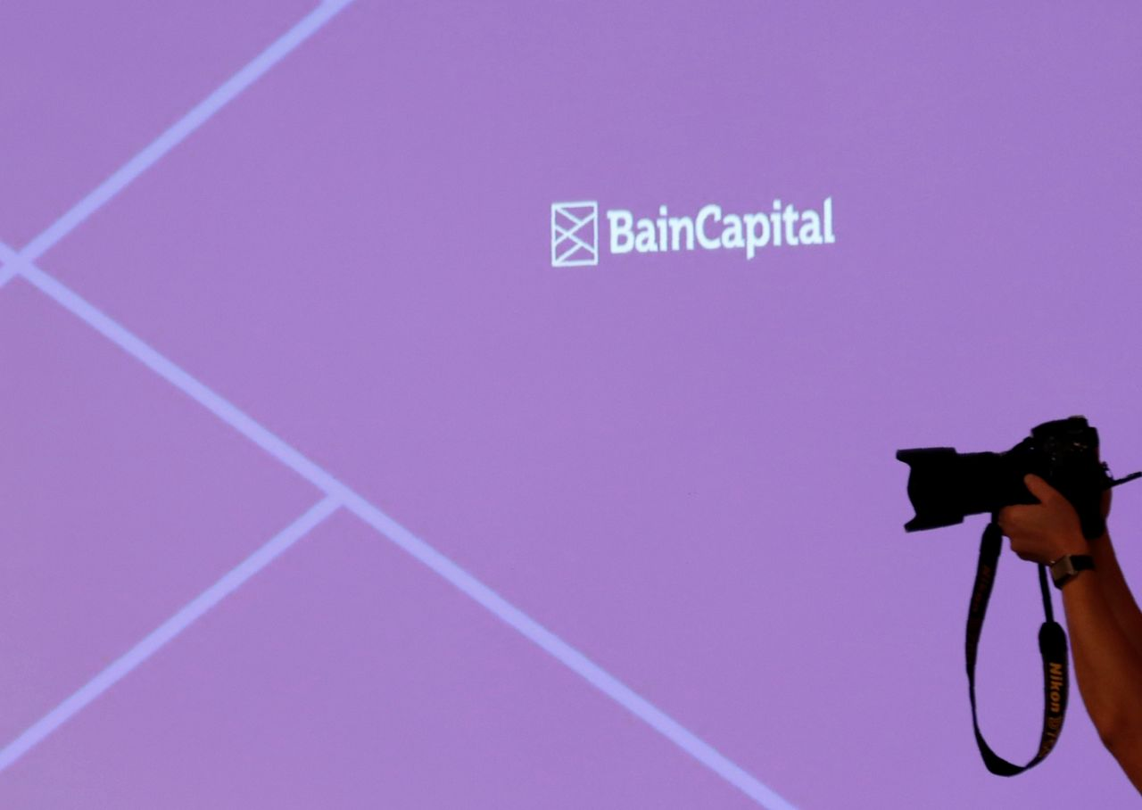 FILE PHOTO: The logo of Bain Capital is displayed on the screen during a news conference in Tokyo, Japan October 5, 2017. REUTERS/Kim Kyung-Hoon