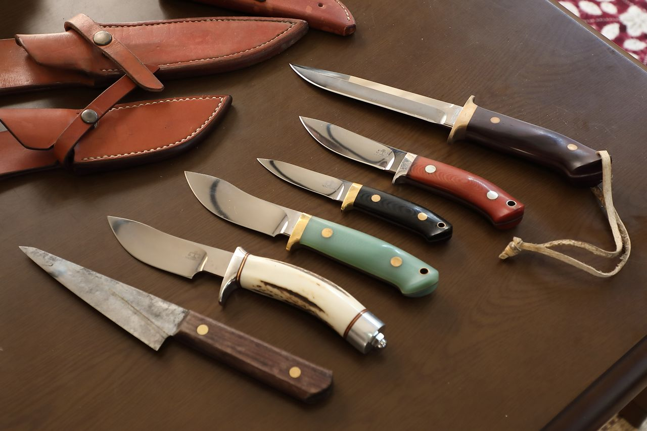 Nozomi's knife collection. The blade at top is used to kill a trapped animal and the other five are for dressing and butchering.