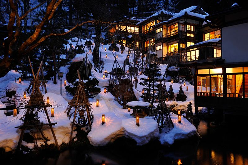 The inner courtyard lit with candles for snow viewing. Hirata introduced the idea in 2001 as a way for guests to enjoy the Aizu snowscape. The bamboo casings are all handmade.