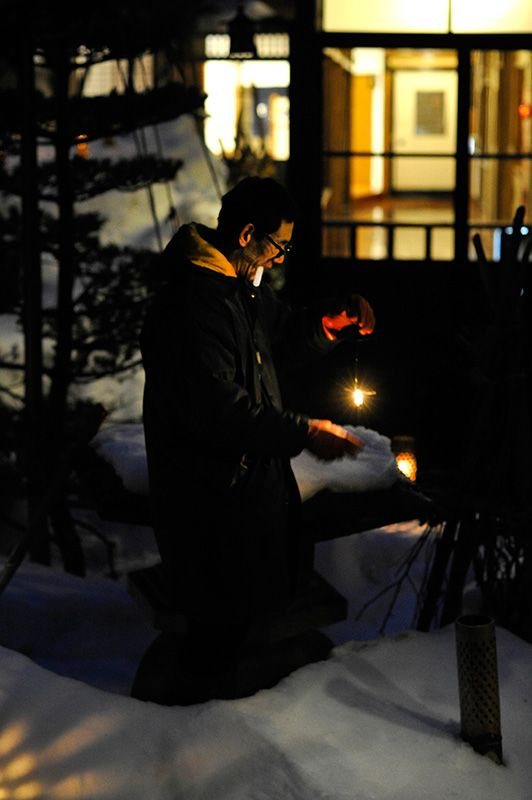An employee replaces burnt-out candles in the sub-zero temperatures.