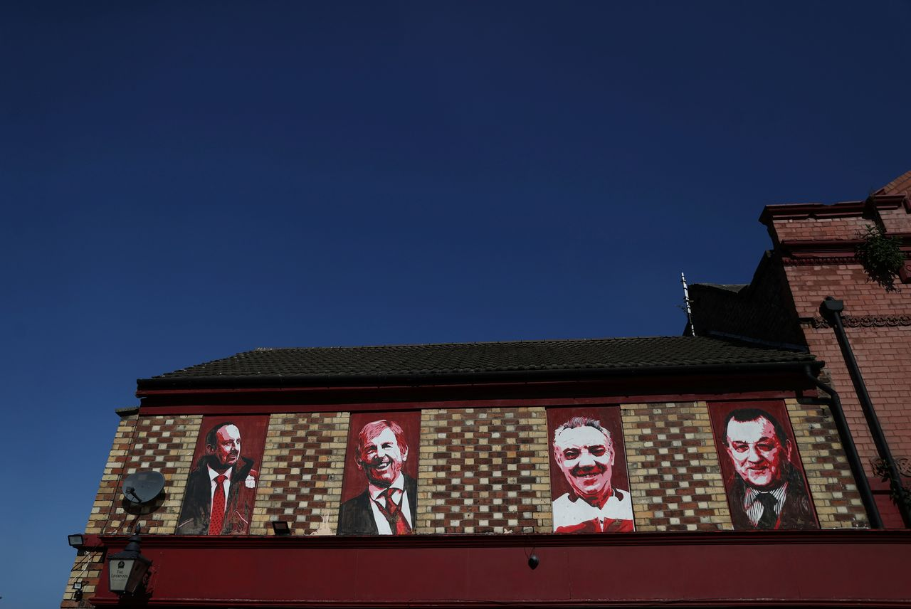 Soccer Football - Images of Rafael Benitez, Kenny Dalglish, Joe Fagan and Bob Paisley are seen outside Anfield as twelve of Europe