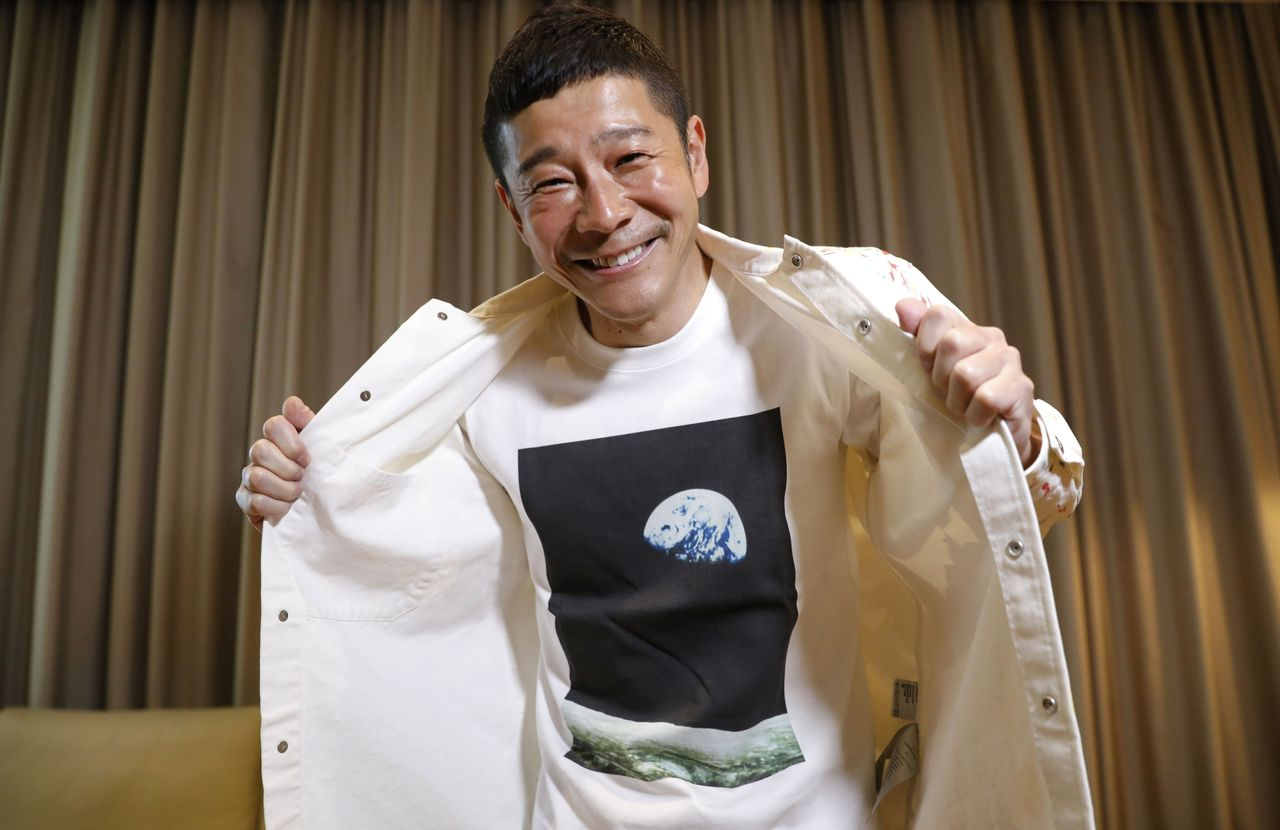Japanese billionaire Yusaku Maezawa poses with his T-shirt bearing an image of Earth during an interview with Reuters in Tokyo, Japan, March 3, 2021. REUTERS/Kim Kyung-Hoon